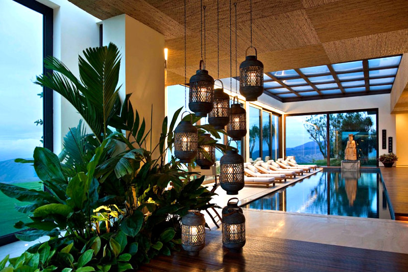 indoor-pool-with-lanterns-and-greenery